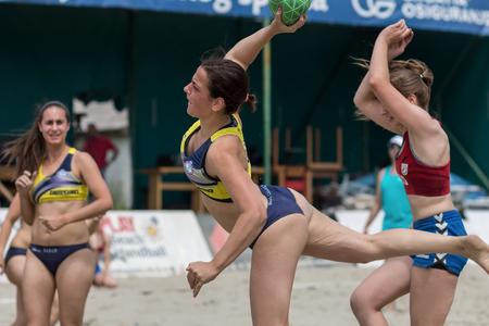 ZAGREB, CROATIA - JUNE 10, 2017: Croatian beach handball championship. Handball player shoot at the goal Publikacyjne