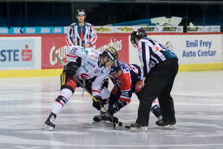 ZAGREB, CROATIA - OCTOBER 31, 2017: EBEL ice hockey league match between Medvescak Zagreb and Orli Znojmo. Tyler MORLEY (86) and David BARTOS (10) in face of