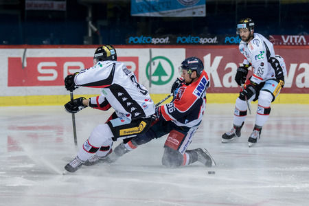 ZAGREB, CROATIA - OCTOBER 31, 2017: EBEL ice hockey league match between Medvescak Zagreb and Orli Znojmo. Tyler MORLEY (86) and Jakub STEHLIK (31) sliding on ice