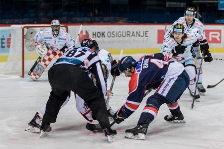 ZAGREB, CROATIA - OCTOBER 31, 2017: EBEL ice hockey league match between Medvescak Zagreb and Orli Znojmo. David BRINE (4) in face off Editorial