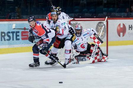 ZAGREB, CROATIA - OCTOBER 31, 2017: EBEL ice hockey league match between Medvescak Zagreb and Orli Znojmo. Tyler MORLEY (86) and Jakub STEHLIK (31) fast skates to get the puck