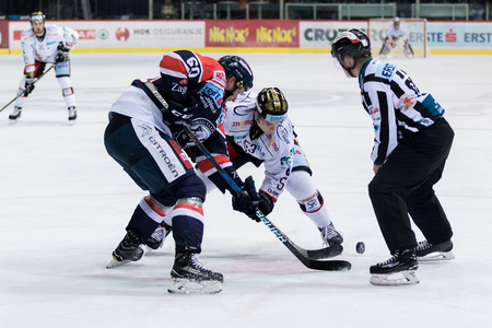 ZAGREB, CROATIA - OCTOBER 31, 2017: EBEL ice hockey league match between Medvescak Zagreb and Orli Znojmo. Hockey players in face off action