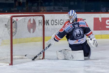 ZAGREB, CROATIA - DECEMBER 21, 2017: EBEL ice hockey league match between Medvescak Zagreb and Dornbirn. Puck in goal, Kevin POULIN (30) goalie