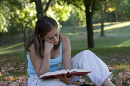 Woman reading a book in the park Stock Photo - 1754183