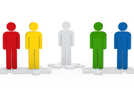 colorful men team figure stand on jisaw Stock Photo - 12728553