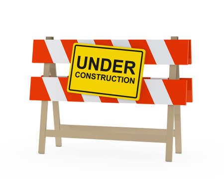 yellow black under construction sign on barrier photo