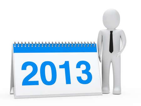 organise: businessman with tie stand next 2013 calendar
