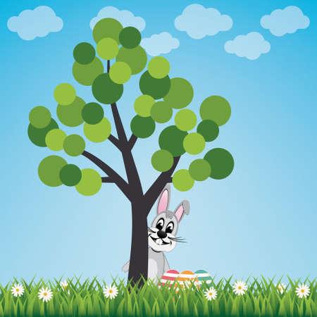 easter tree: bunny behind free spring landscape