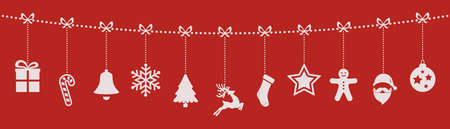 christmas ornaments hanging rope red background