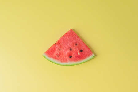 Watermelon piece on creative yellow background Stok Fotoğraf