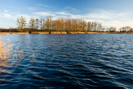 Wonderful Lake Stankow in eastern Poland, waves and leafless trees Stock Photo