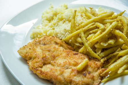 Polish dish with a cutlet, string bean and bulgur
