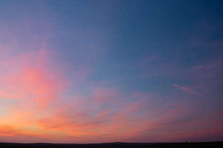 Beautiful colorful clouds after sunset on blue sky Foto de archivo - 140648890