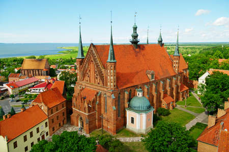 warmia: Frombork, Poland - June 22, 2014 : Aerial view of the Arch-cathedral Basilica of Assumption of Blessed Virgin Mary and Saint Andrew in Frombork. Editorial