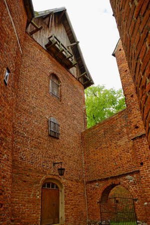 warmia: Frombork, Poland - June 22, 2014 : Tower and fragment of a defensive wall of the Arch-cathedral in Frombork.