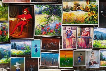 in the open air: Cracow, Poland - July 13, 2014: Fragment of an open air art gallery with paintings for sale.