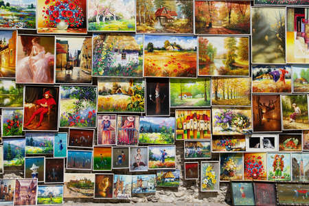 Cracow, Poland - July 13, 2014: Fragment of an open air art gallery with paintings for sale.