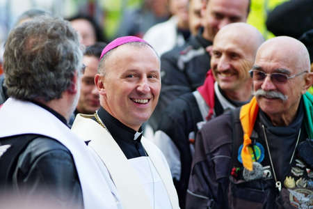 praga: Warsaw, Poland - August 23, 2014: Marek Solarczyk, auxiliary Bishop of Warsaw-Praga diocese, greets participants of the 14th International Motorcycle Katyn Rally.