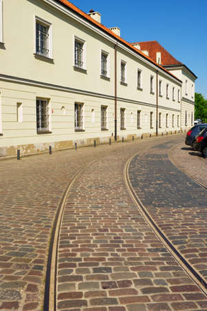 Warsaw, Poland - May 6, 2014 : Original pre-war tram tracks on Bohaterow Getta (Ghetto Heroes) Street with the adjacent Arsenal building in Warsaw.