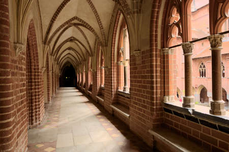order in: Malbork, Poland - June 23, 2015 Cloister in the medieval Castle of the Teutonic Order in Malbork Marienburg.