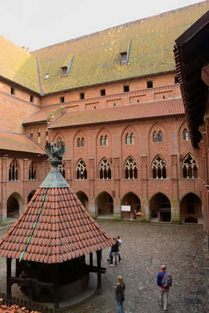 teutonic: Malbork, Poland - June 23, 2015 Yard with arcades and galleries in the medieval Castle of the Teutonic Order in Malbork Marienburg.