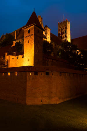 order in: Malbork, Poland - June 23, 2015: Night view of the medieval Castle of the Teutonic Order in Malbork Marienburg