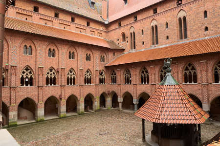 arcades: Malbork, Poland - June 23, 2015 Yard with arcades and galleries in the medieval Castle of the Teutonic Order in Malbork Marienburg.