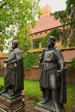 teutonic: Malbork, Poland - June 23, 2015: Statues of the Grand Masters of the Teutonic Knights in the medieval Castle in Malbork Marienburg. Editorial