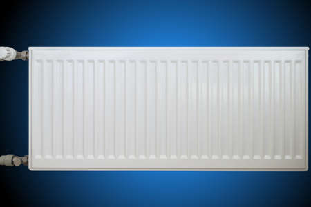convection: White convective heat sink on blue background. Stock Photo