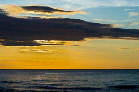 dawns: Dramatic stratus cloud formations at sunset over the Baltic sea. Gdansk Bay, Pomerania, northern Poland.