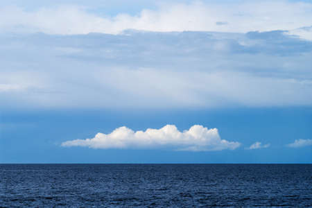 White cumulus and altostratus cloud formation over the Baltic sea.