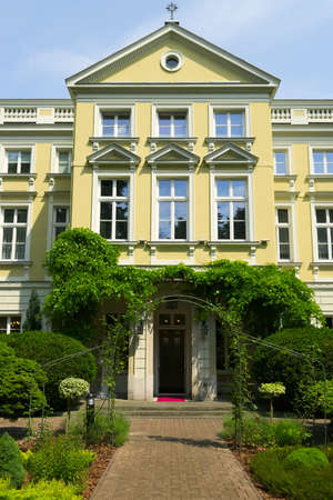 storied: Borch Palace - House of the Archbishops of Warsaw on May 25, 2014 in Warsaw, Poland. View from the garden.