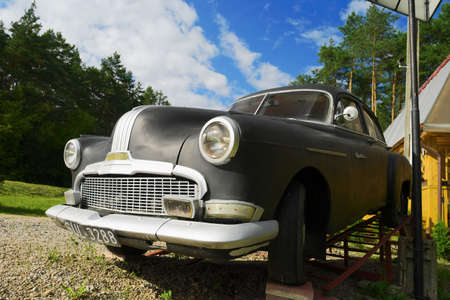 the view from below: Frontal view from below of classic black 1950 Pontiac Chieftain four-door sedan car. August 14, 2016 near Rajgrod, Podlasie, Poland. Editorial