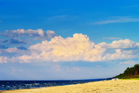 Cloudscape with huge cumulonimbus cloud formation over the beach at the Baltic sea. Stegna, Pomerania, northern Poland.
