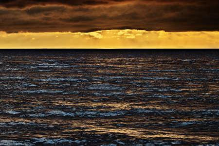 Seascape at sunset with stunning nimbostratus cloud formation over the Baltic sea. Pomerania, Poland.
