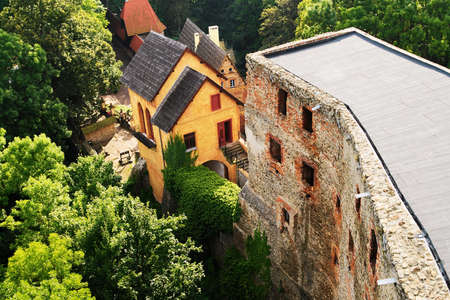 Grodno Castle on September 6, 2017 in Zagorze Slaskie, Poland. Gatehouse building built in 16th century and ruined castle walls. Aerial view. Editorial