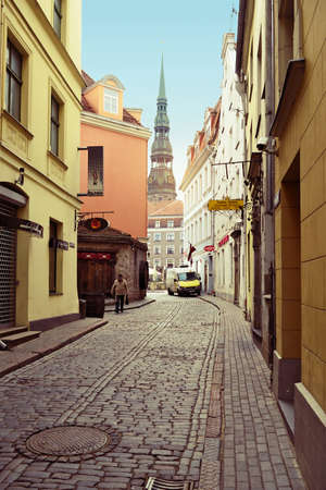 Riga, Latvia. Kramu iela street on April 25, 2017 in Riga. Narrow medieval cobbled street with tenement houses in the old town of Riga. Redakční