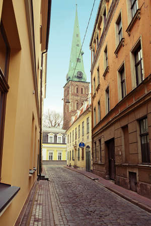 Riga, Latvia. Narrow medieval cobbled Maza Miesnieku iela street with tenement houses on April 25, 2017 in the old town of Riga.