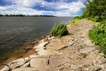 The mouth of the Vistula River on the Baltic Sea with a stone river embankment on a sunny day. Pomerania, Poland. Reklamní fotografie