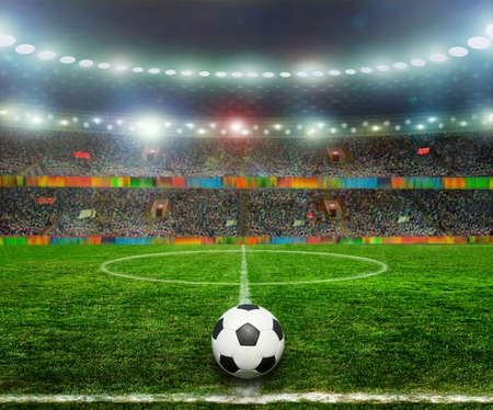 soccer ball on grass: Soccer ball on the field of stadium with light Stock Photo