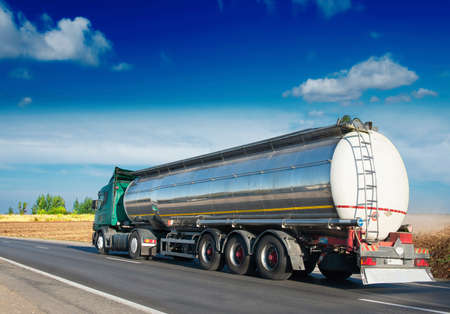 truck on highway: big fuel gas tanker truck on highway