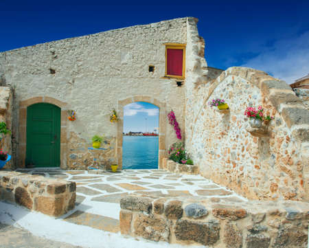 skiathos: Traditional greek door with a great view on Crete island, Greece