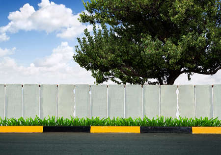 side road: white fence and green grass