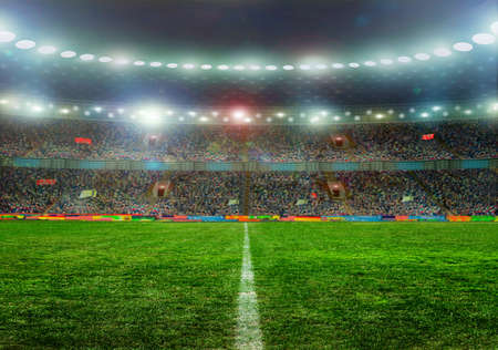 background  grass: Soccer ball on the field of stadium with light Stock Photo
