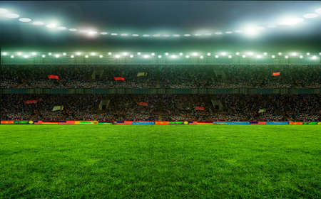 Soccer stadium, arena in night illuminated bright spotlights Stock Photo