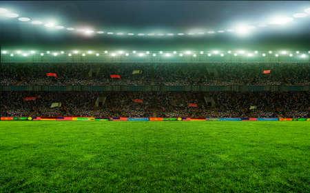 Soccer stadium, arena in night illuminated bright spotlights Banque d'images