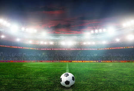 Soccer ball on the field of stadium with light Stock Photo