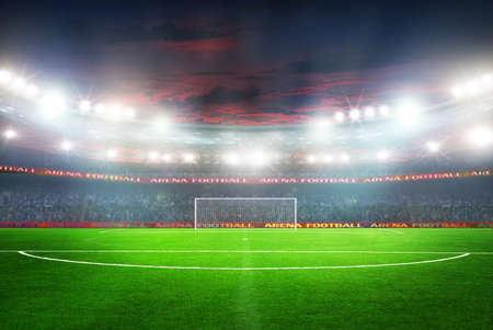 day light: Soccer ball on the field of stadium with light Stock Photo