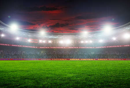 campeonato de futbol: estadio de fútbol antes del partido. iluminación nocturna