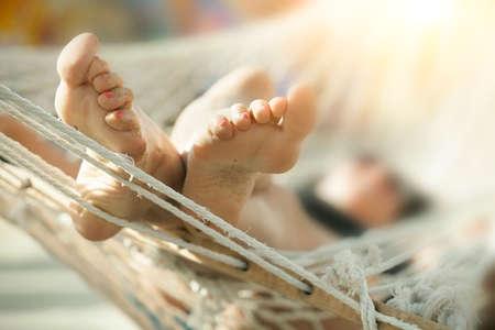 unworried: girl in a hammock on the beach